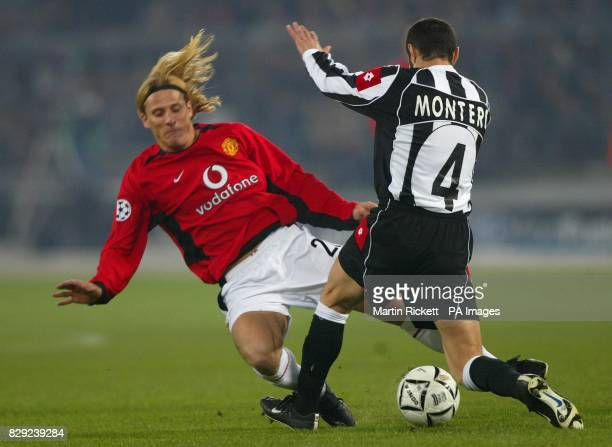 Manchester United's Diego Forlan battles with Paolo Montero of Juventus before sustaining an injury during their Champions League group D phase 2...