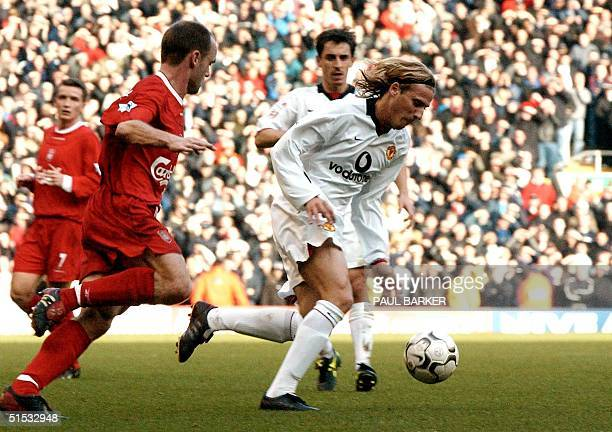 Manchester United's Diego Forlan moves past Liverpool's Danny Murphy during their Premiership clash at Anfield Liverpool 01 December 2002 AFP Photo...