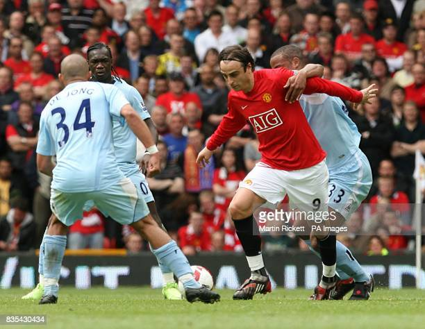 Manchester United's Dimitar Berbatov and Manchester City's Vincent Kompany battle for the ball