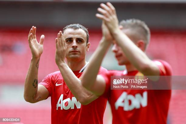 Manchester United's Dimitar Berbatov and Tom Cleverley applaud the fans after the final whistle