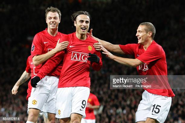 Manchester United's Dimitar Berbatov celebrates after scoring the opening goal of the game with team mates Jonny Evans and Nemanja Vidic