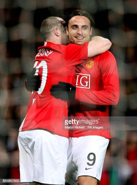 Manchester United's Dimitar Berbatov celebrates after scoring the second goal of the game with team mate Wayne Rooney