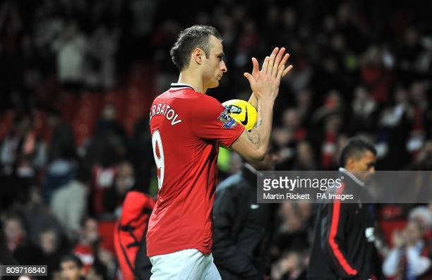 Manchester United's Dimitar Berbatov celebrates his hattrick as he walks off the pitch clutching the matchball