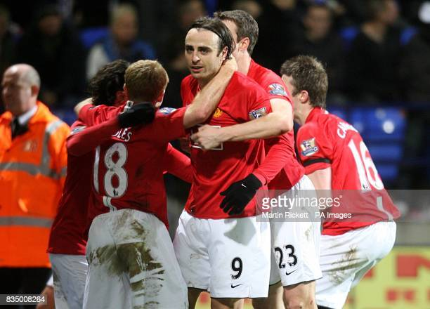 Manchester United's Dimitar Berbatov celebrates with his team mates after scoring the opening goal of the game