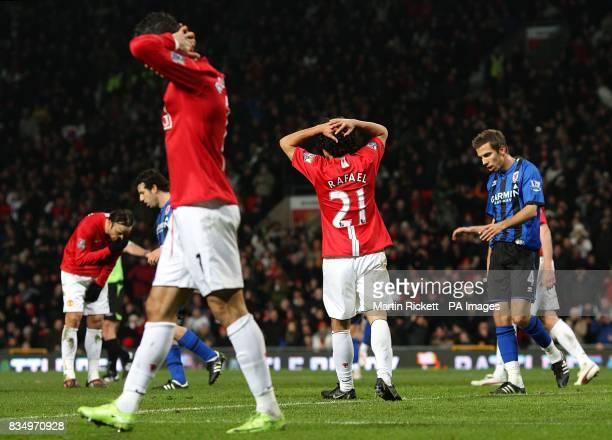 Manchester United's Dimitar Berbatov Cristiano Ronaldo and Rafael Da Silva dejected after a missed chance