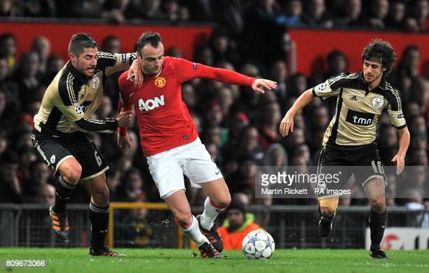 Manchester United's Dimitar Berbatov in action with Benfica's Pablo Aimar annd Francisco Javi Garcia