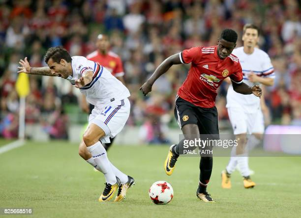 Manchester United's DR Congoborn defender Axel Tuanzebe vies with Sampdoria's Ricardo Alvarez during the preseason friendly game between Manchester...
