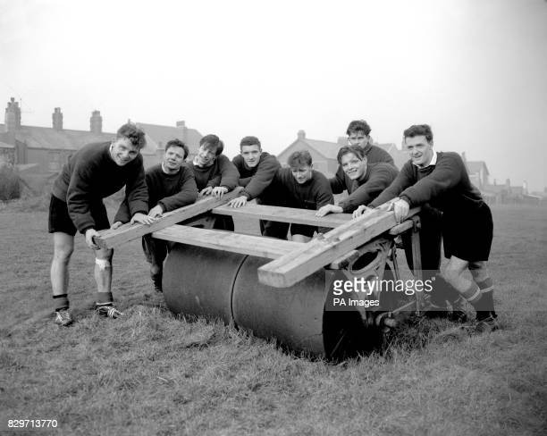 Manchester United's Duncan Edwards Johnny Berry Dennis Viollet Bill Foulkes Roger Byrne Wilf McGuinness Mark Jones and Billy Whelan work on their...