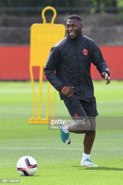 Manchester United's Dutch defender Timothy FosuMensah attends a team training session at the club's training complex near Carrington west of...