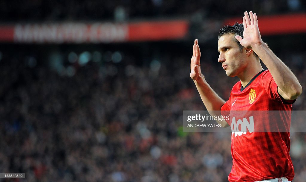 "Manchester United's Dutch forward Robin van Persie celebrates scoring the first goal against Aresnal during their English Premier League football match at Old Trafford in Manchester, northwest England, on November 3, 2012. AFP PHOTO/ANDREW YATES == RESTRICTED TO EDITORIAL USE. No use with unauthorized audio, video, data, fixture lists, club/league logos or ""live"" services. Online in-match use limited to 45 images, no video emulation. No use in betting, games or single club/league/player publications =="