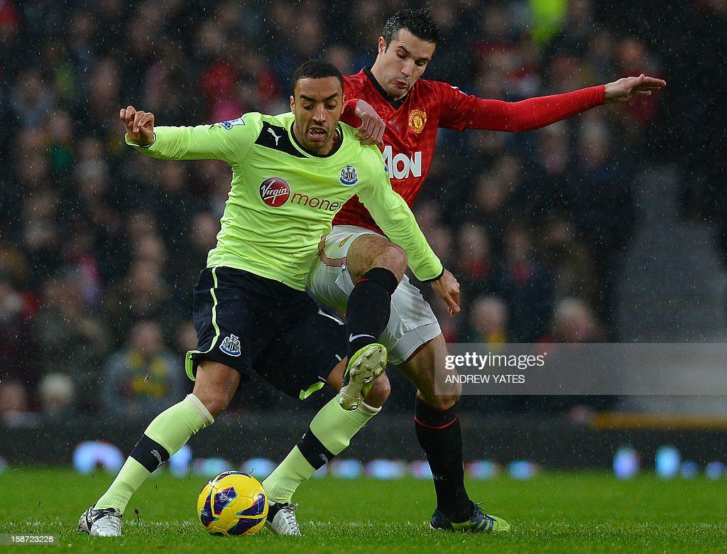 """Manchester United's Dutch forward Robin van Persie (R) vies with Newcastle United's English defender James Perch (L) during the English Premier League football match between Manchester United and Newcastle United at Old Trafford in Manchester, north-west England on December 26, 2012. USE. No use with unauthorized audio, video, data, fixture lists, club/league logos or """"live"""" services. Online in-match use limited to 45 images, no video emulation. No use in betting, games or single club/league/player publications"""