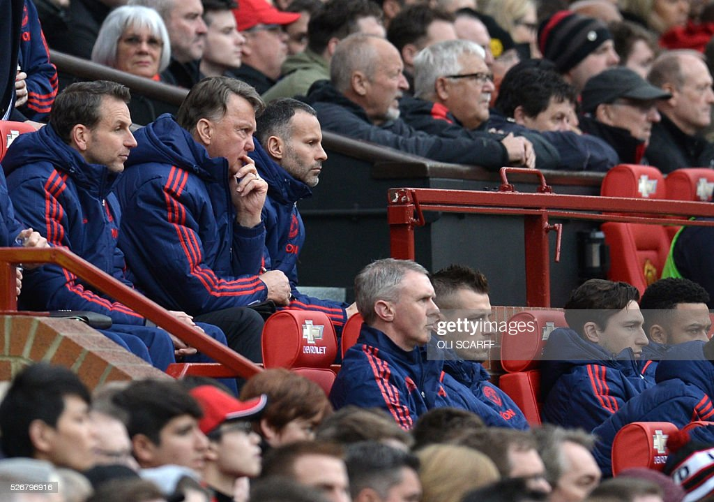 Manchester United's Dutch manager Louis van Gaal (top 2L) and Manchester United's Welsh assistant manager Ryan Giggs (3L) during the English Premier League football match between Manchester United and Leicester City at Old Trafford in Manchester, north west England, on May 1, 2016. / AFP / OLI SCARFF / RESTRICTED TO EDITORIAL USE. No use with unauthorized audio, video, data, fixture lists, club/league logos or 'live' services. Online in-match use limited to 75 images, no video emulation. No use in betting, games or single club/league/player publications. /