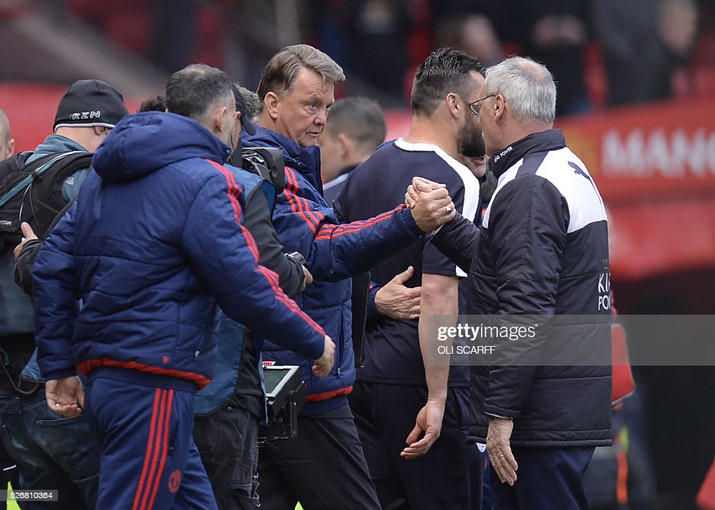 Manchester United's Dutch manager Louis van Gaal (L) greets Leicester City's Italian manager Claudio Ranieri after the English Premier League football match between Manchester United and Leicester City at Old Trafford in Manchester, north west England, on May 1, 2016. / AFP / OLI SCARFF / RESTRICTED TO EDITORIAL USE. No use with unauthorized audio, video, data, fixture lists, club/league logos or 'live' services. Online in-match use limited to 75 images, no video emulation. No use in betting, games or single club/league/player publications. /