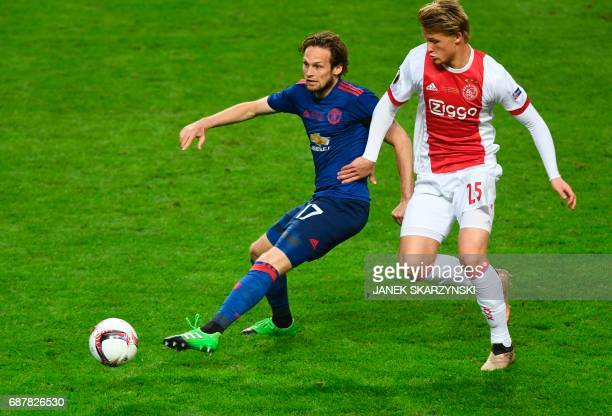 Manchester United's Dutch midfielder Daley Blind and Ajax Danish forward Kasper Dolberg vie for the ball during the UEFA Europa League final football...