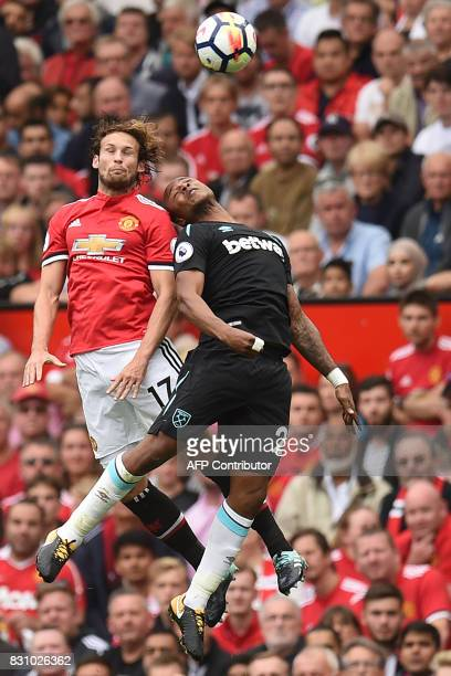 Manchester United's Dutch midfielder Daley Blind vies with West Ham United's Frenchborn Ghanaian midfielder Andre Ayew during the English Premier...