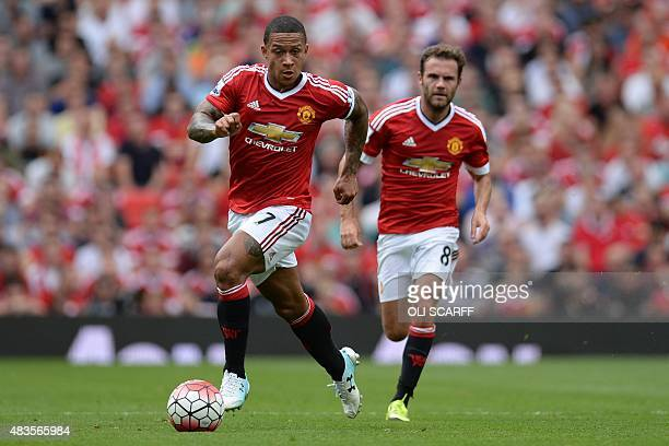 Manchester United's Dutch striker Memphis Depay runs during the English Premier League football match between Manchester United and Tottenham Hotspur...