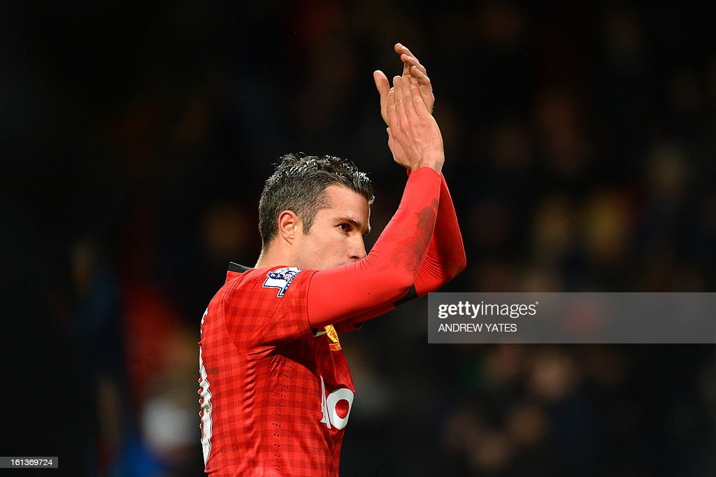 "Manchester United's Dutch striker Robin van Persie acknowledges the crowd after the final whistle in the English Premier League football match between Manchester United and Everton at Old Trafford, Manchester, North West England, on February 10, 2013. Manchester United won the match 2-0 to secure a 12 point lead at the top of the Premier League table. USE. No use with unauthorized audio, video, data, fixture lists, club/league logos or ""live"" services. Online in-match use limited to 45 images, no video emulation. No use in betting, games or single club/league/player publications."