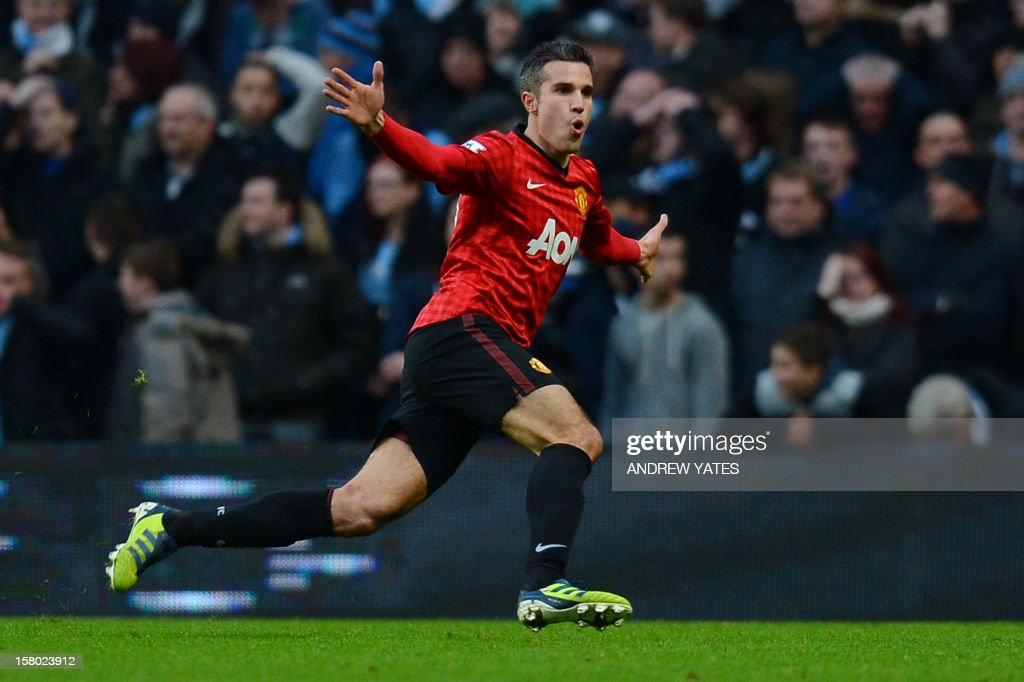 "Manchester United's Dutch striker Robin Van Persie celebrates scoring his late winning goal in the English Premier League football match between Manchester City and Manchester United at The Etihad stadium in Manchester, north-west England on December 9, 2012. AFP PHOTO/ANDREW YATES USE. No use with unauthorized audio, video, data, fixture lists, club/league logos or ""live"" services. Online in-match use limited to 45 images, no video emulation. No use in betting, games or single club/league/player publications."