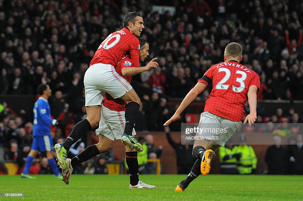 """Manchester United's Dutch striker Robin van Persie (L) climbs on the back of Manchester United's Welsh midfielder Ryan Giggs (C) as Manchester United's English midfielder Tom Cleverley (R) runs in to celebrate Giggs's opening goal during the English Premier League football match between Manchester United and Everton at Old Trafford, Manchester, North West England, on February 10, 2013. AFP PHOTO / ANDREW YATES USE. No use with unauthorized audio, video, data, fixture lists, club/league logos or """"live"""" services. Online in-match use limited to 45 images, no video emulation. No use in betting, games or single club/league/player publications."""