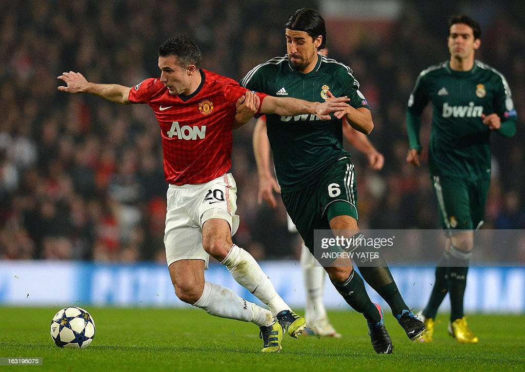 Manchester United's Dutch striker Robin van Persie (L) is challenged by Real Madrid's German midfielder Sami Khedira (R) during the UEFA Champions League round of 16 second leg football match between Manchester United and Real Madrid at Old Trafford in Manchester, northwest England on March 5, 2013. Real Madrid won 2-1 (3-2 on aggregate).