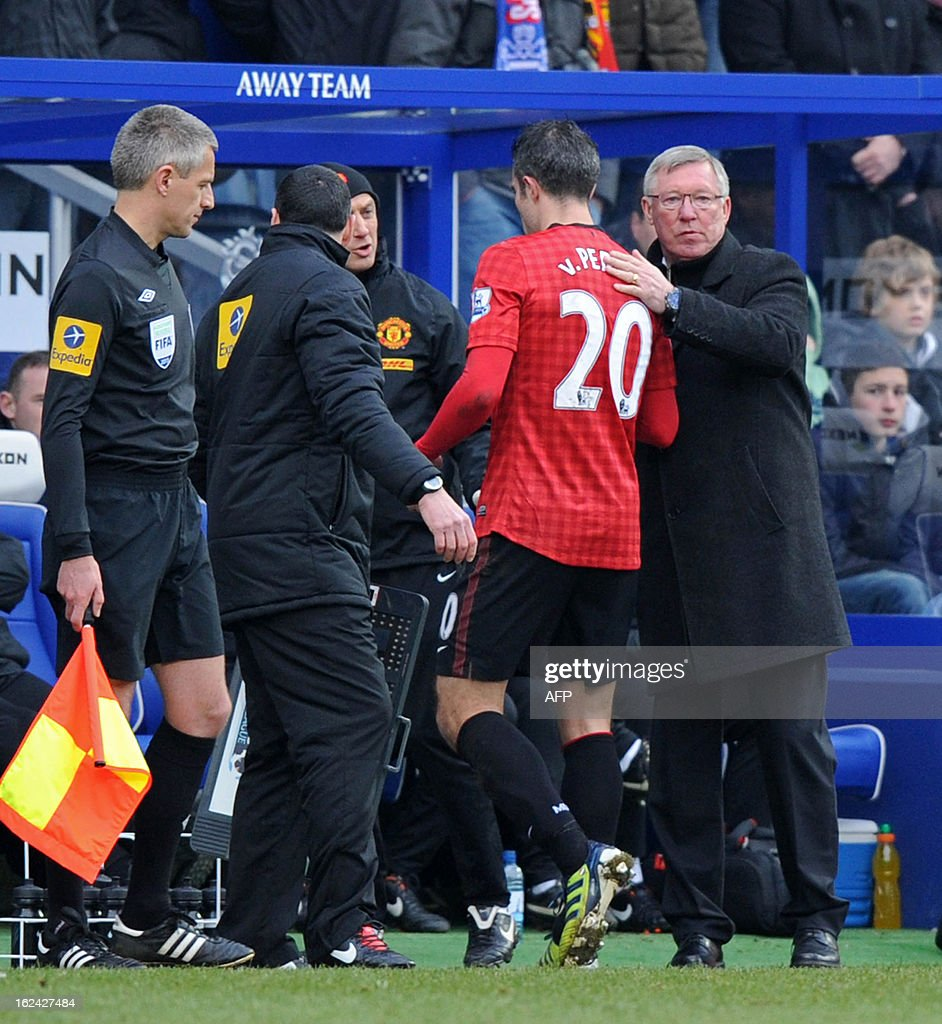 "Manchester United's Dutch striker Robin van Persie (2nd R) is substituted by Scottish manager Alex Ferguson (R) after picking up an injury during the English Premier League football match between Queens Park Rangers and Manchester United at Loftus Road in London on February 23, 2013. USE. No use with unauthorized audio, video, data, fixture lists, club/league logos or ""live"" services. Online in-match use limited to 45 images, no video emulation. No use in betting, games or single club/league/player publications"