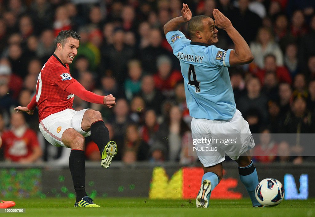 """Manchester United's Dutch striker Robin van Persie (L) shoots past Manchester City's Belgian defender Vincent Kompany (R) during the English Premier League football match between Manchester United and Manchester City at Old Trafford in Manchester, northwest England on April 8, 2013. USE. No use with unauthorized audio, video, data, fixture lists, club/league logos or """"live"""" services. Online in-match use limited to 45 images, no video emulation. No use in betting, games or single club/league/player publications."""