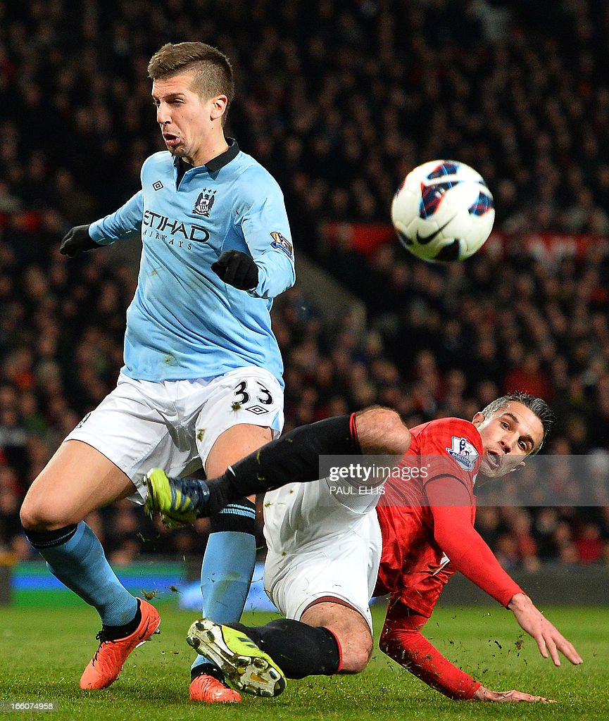 """Manchester United's Dutch striker Robin van Persie (R) vies with Manchester City's Serbian defender Matija Nastasic (L) during the English Premier League football match between Manchester United and Manchester City at Old Trafford in Manchester, northwest England on April 8, 2013. Manchester City won the game 2-1. USE. No use with unauthorized audio, video, data, fixture lists, club/league logos or """"live"""" services. Online in-match use limited to 45 images, no video emulation. No use in betting, games or single club/league/player publications."""