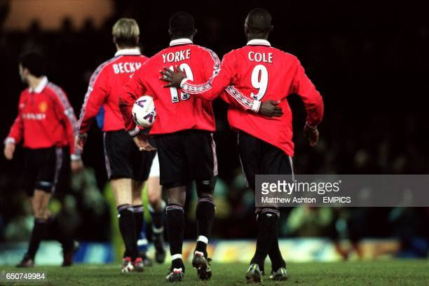 Manchester United's Dwight Yorke leaves the field with the matchball after scoring a hattrick along with Andy Cole