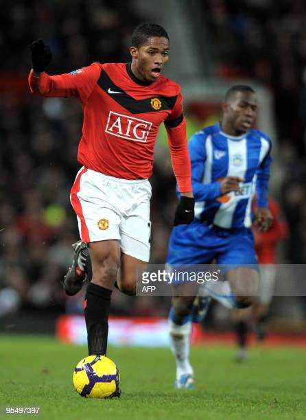 Manchester United's Ecuador midfielder Antonio Valencia looks to attack during the English Premier League football match against Wigan Athletic at...