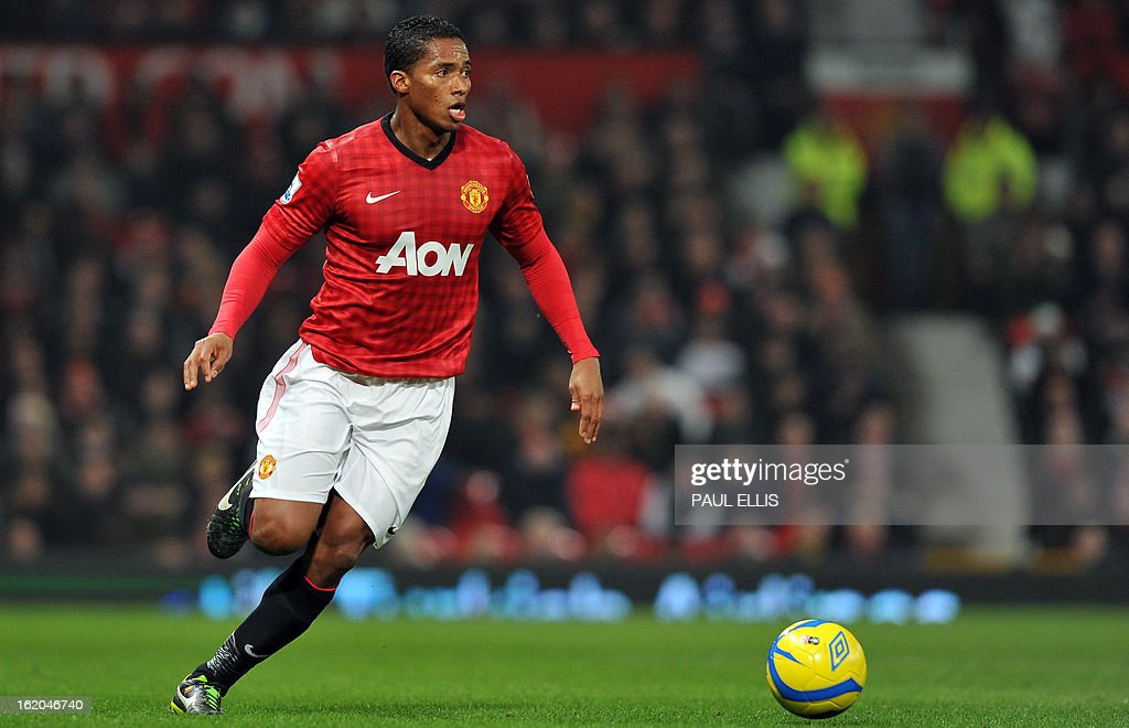 "Manchester United's Ecuador midfielder Antonio Valencia runs with the ball during the English FA Cup fifth round football match between Manchester United and Reading at Old Trafford in Manchester, north west England, on February 18, 2013. USE. No use with unauthorized audio, video, data, fixture lists, club/league logos or ""live"" services. Online in-match use limited to 45 images, no video emulation. No use in betting, games or single club/league/player publications."