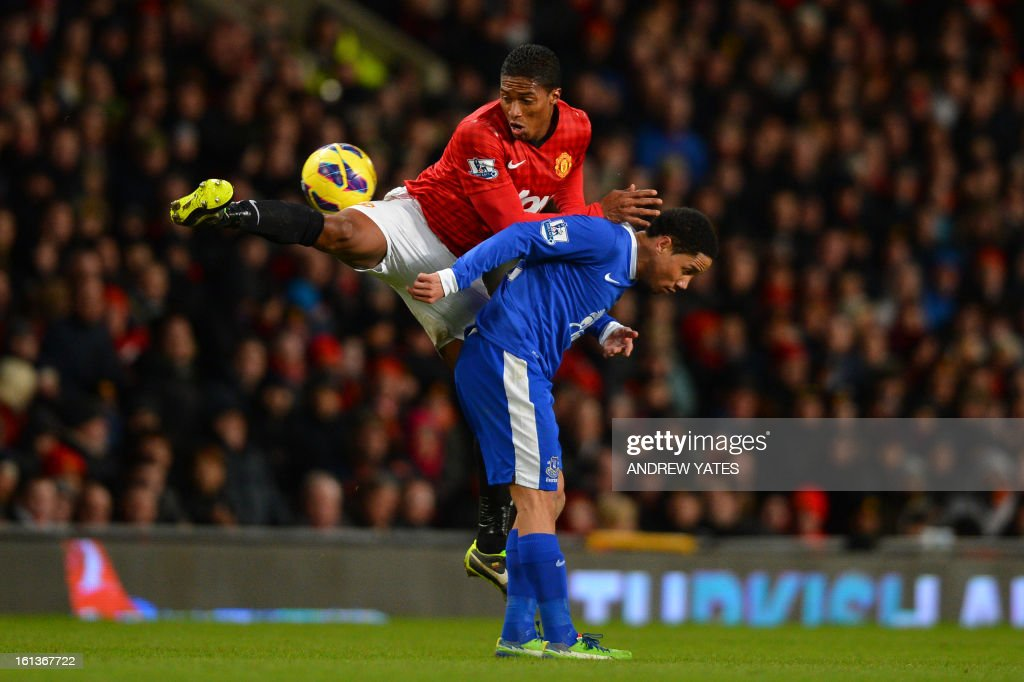 "Manchester United's Ecuador midfielder Antonio Valencia (L) vies with Everton's South African midfielder Steven Pienaar (R) during the English Premier League football match between Manchester United and Everton at Old Trafford, Manchester, North West England, on February 10, 2013. USE. No use with unauthorized audio, video, data, fixture lists, club/league logos or ""live"" services. Online in-match use limited to 45 images, no video emulation. No use in betting, games or single club/league/player publications."