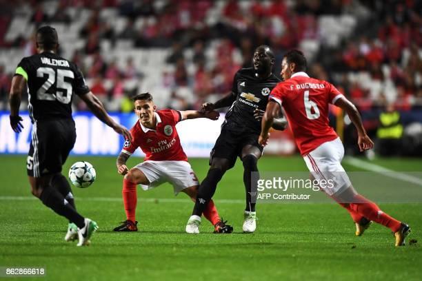 Manchester United's Ecuadorian defender Antonio Valencia Benfica's Spanish defender Grimaldo Garcia Manchester United's Belgian forward Romelu Lukaku...