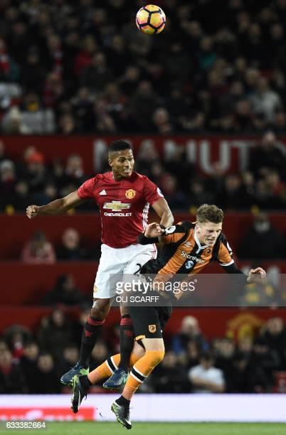 Manchester United's Ecuadorian midfielder Antonio Valencia vies with Hull City's English defender Josh Tymon during the English Premier League...