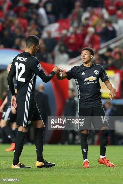 Manchester United's English defender Chris Smalling celebrates the victory with Manchester United's English midfielder Jesse Lingard after the UEFA...