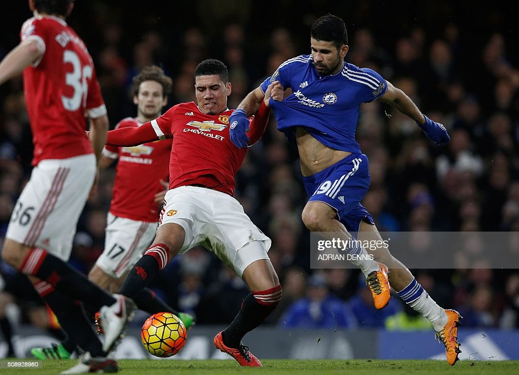 Manchester United's English defender Chris Smalling (L) clashes with Chelsea's Brazilian-born Spanish striker Diego Costa during the English Premier League football match between Chelsea and Manchester United at Stamford Bridge in London on February 7, 2016. / AFP / ADRIAN DENNIS / RESTRICTED TO EDITORIAL USE. No use with unauthorized audio, video, data, fixture lists, club/league logos or 'live' services. Online in-match use limited to 75 images, no video emulation. No use in betting, games or single club/league/player publications. /