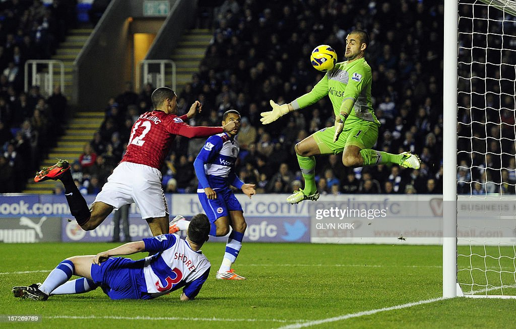 "Manchester United's English defender Chris Smalling (L) has his header saved by Reading's Australian goalkeeper Adam Federici (R) during the English Premier League football match between Reading and Manchester United at the Madejski Stadium, in Reading, Berkshire, southern England, on December 1, 2012. USE. No use with unauthorized audio, video, data, fixture lists, club/league logos or ""live"" services. Online in-match use limited to 45 images, no video emulation. No use in betting, games or single club/league/player publications"