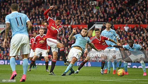 Manchester United's English defender Chris Smalling takes an unsuccessful shot on goal during the English Premier League football match between...