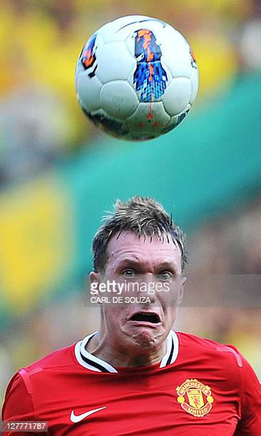 Manchester United's English defender Phil Jones watches the ball during the English Premier League football match between Manchester United and...
