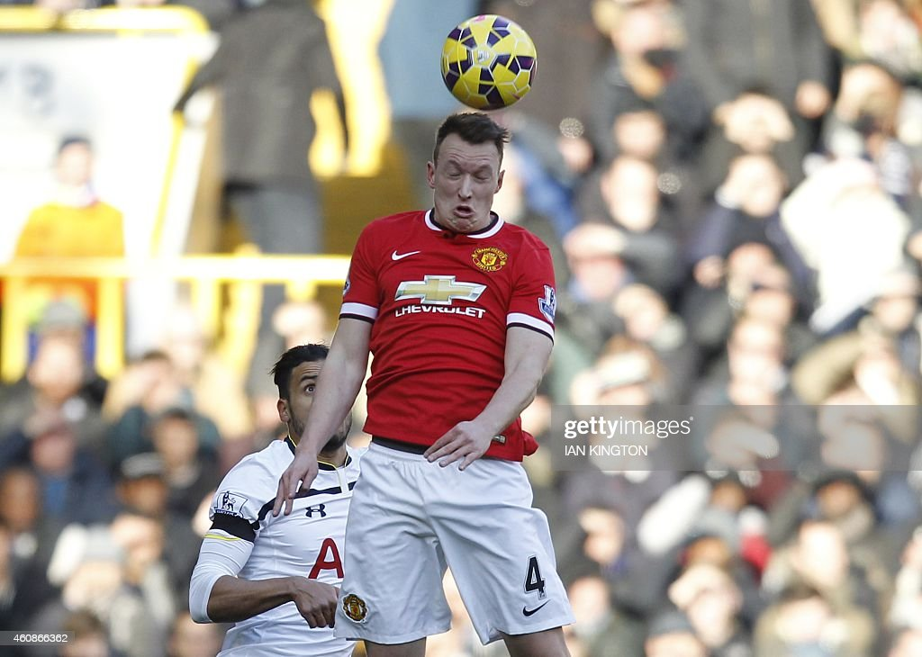 Manchester United's English defender <a gi-track='captionPersonalityLinkClicked' href=/galleries/search?phrase=Phil+Jones+-+Soccer+Player&family=editorial&specificpeople=7841291 ng-click='$event.stopPropagation()'>Phil Jones</a> (R) wins a header during the English Premier League football match between Tottenham Hotspur and Manchester United at White Hart Lane in London on December 28, 2014. AFP PHOTO / IAN KINGTON == RESTRICTED TO EDITORIAL USE. NO USE WITH UNAUTHORIZED AUDIO, VIDEO, DATA, FIXTURE LISTS, CLUB/LEAGUE LOGOS OR LIVE SERVICES. ONLINE IN-MATCH USE LIMITED TO 45 IMAGES, NO VIDEO EMULATION. NO USE IN BETTING, GAMES OR SINGLE CLUB/LEAGUE/PLAYER PUBLICATIONS. ==