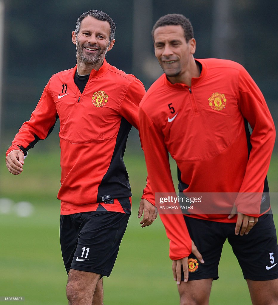 Manchester United's English defender Rio Ferdinand (R) and Manchester United's Welsh midfielder Ryan Giggs attend a training session at the team's Carrington training complex in Manchester, north-west England on October 1, 2013, on the eve of their UEFA Champions League group A football match against Shakhtar Donetsk in the Ukraine. AFP PHOTO/ANDREW YATES