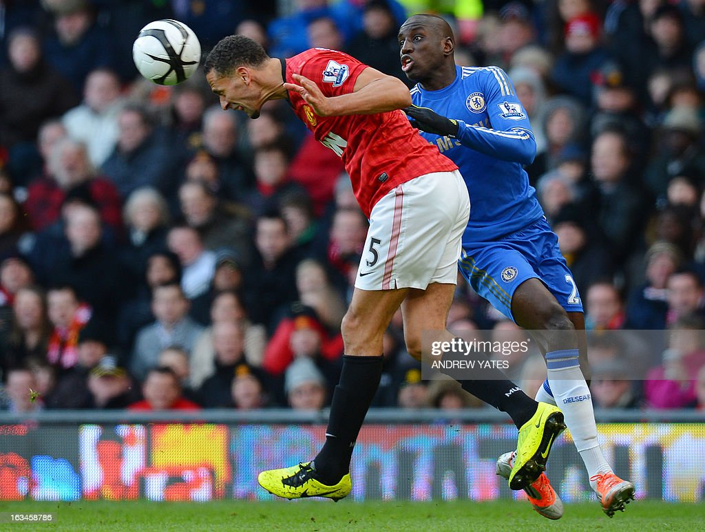 """Manchester United's English defender Rio Ferdinand (L) heads clear from Chelsea's Senegalese forward Demba Ba during the English FA Cup quarter-final football match between Manchester United and Chelsea at Old Trafford, Manchester, northwest England on March 10, 2013. USE. No use with unauthorized audio, video, data, fixture lists, club/league logos or """"live"""" services. Online in-match use limited to 45 images, no video emulation. No use in betting, games or single club/league/player publications."""