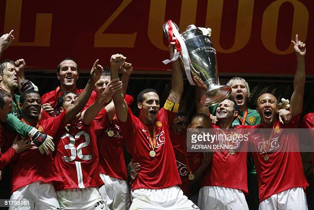 Manchester United's English defender Rio Ferdinand holds up the trophy after beating Chelsea in the final of the Champions League football match at...