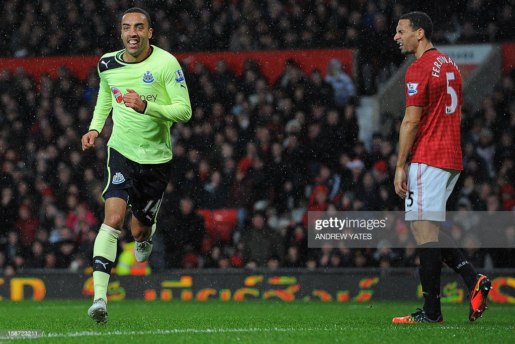 "Manchester United's English defender Rio Ferdinand (R) reacts as Newcastle United's English defender James Perch (L) celebrates after opening the scoring during the English Premier League football match between Manchester United and Newcastle United at Old Trafford in Manchester, north-west England on December 26, 2012. USE. No use with unauthorized audio, video, data, fixture lists, club/league logos or ""live"" services. Online in-match use limited to 45 images, no video emulation. No use in betting, games or single club/league/player publications"