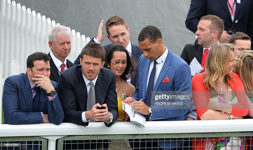 Manchester United's English defender Rio Ferdinand (C) signs an autograph next to Manchester United's English midfielder Michael Carrick (2R) at the Chester Races horse racing event at Chester Racecourse in Cheshire, northwest England on May 8, 2013. Alex Ferguson will retire as Manchester United boss at the end of the season, the Premier League champions announced on May 8, ending the most successful managerial reign in English football.