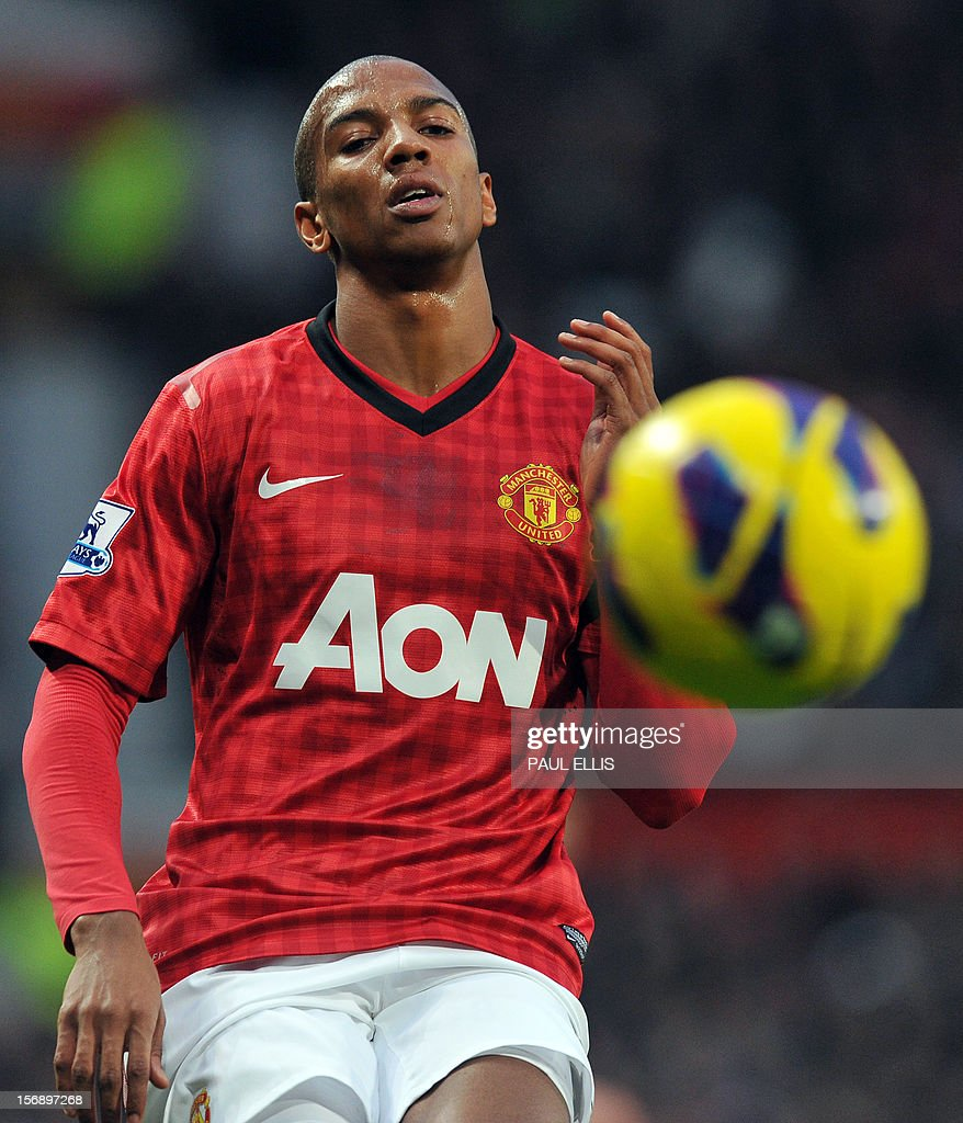 """Manchester United's English forward Ashley Young chases the ball during the English Premier League football match between Manchester United and Queens Park Rangers at Old Trafford in Manchester, north-west England, on November 24, 2012. USE. No use with unauthorized audio, video, data, fixture lists, club/league logos or """"live"""" services. Online in-match use limited to 45 images, no video emulation. No use in betting, games or single club/league/player publications"""