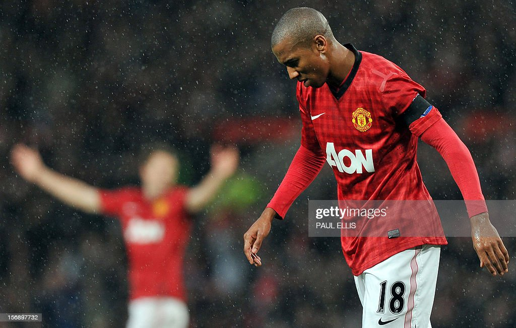 """Manchester United's English forward Ashley Young reacts to a missed opportunity during the English Premier League football match between Manchester United and Queens Park Rangers at Old Trafford in Manchester, north-west England, on November 24, 2012. USE. No use with unauthorized audio, video, data, fixture lists, club/league logos or """"live"""" services. Online in-match use limited to 45 images, no video emulation. No use in betting, games or single club/league/player publications"""