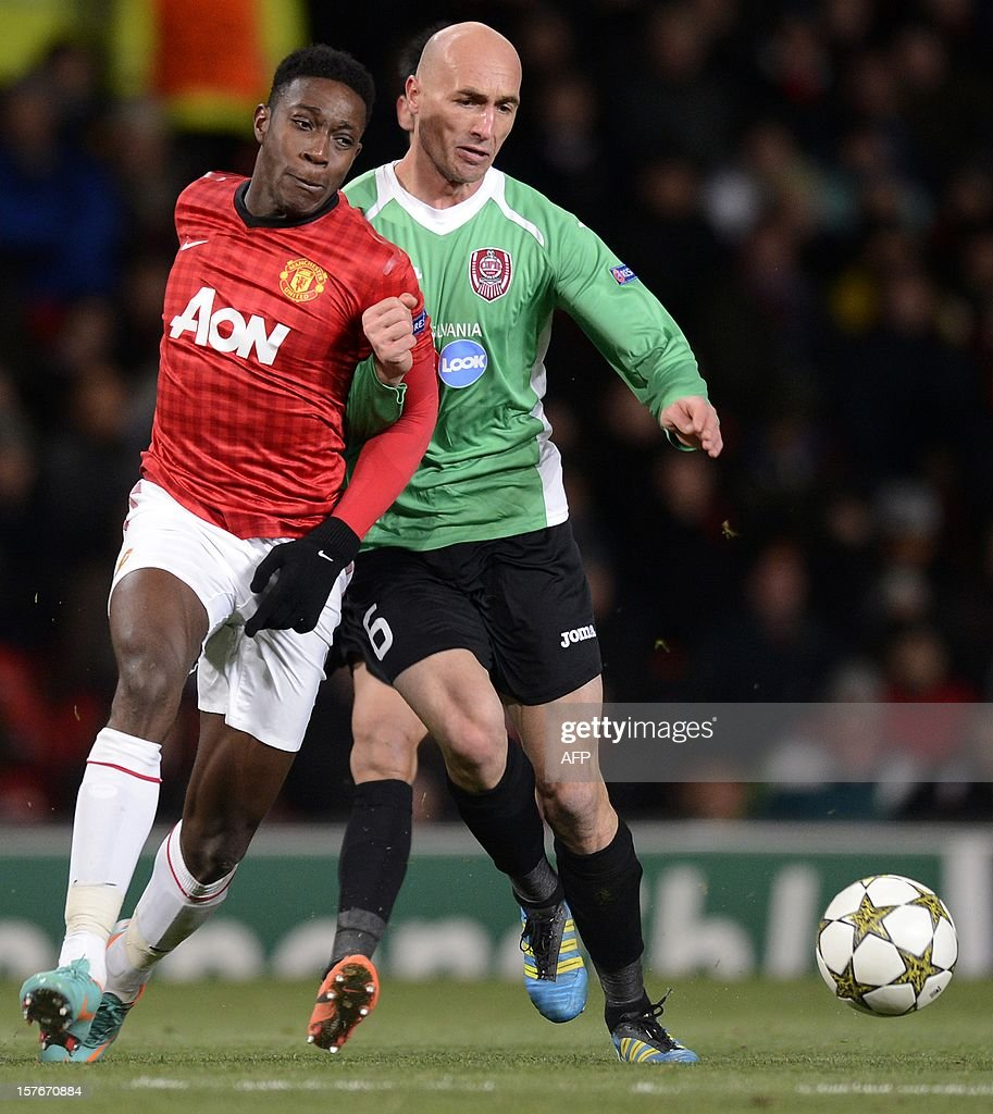 Manchester United's English forward Danny Welbeck (L) vies with Cluj's Romanian midfielder Gabriel Muresan during the UEFA Champions League group H football match between Manchester United and CFR Cluj-Napoca at Old Trafford in Manchester, north-west England, on December 5, 2012. CFR Cluj-Napoca won 1-0.