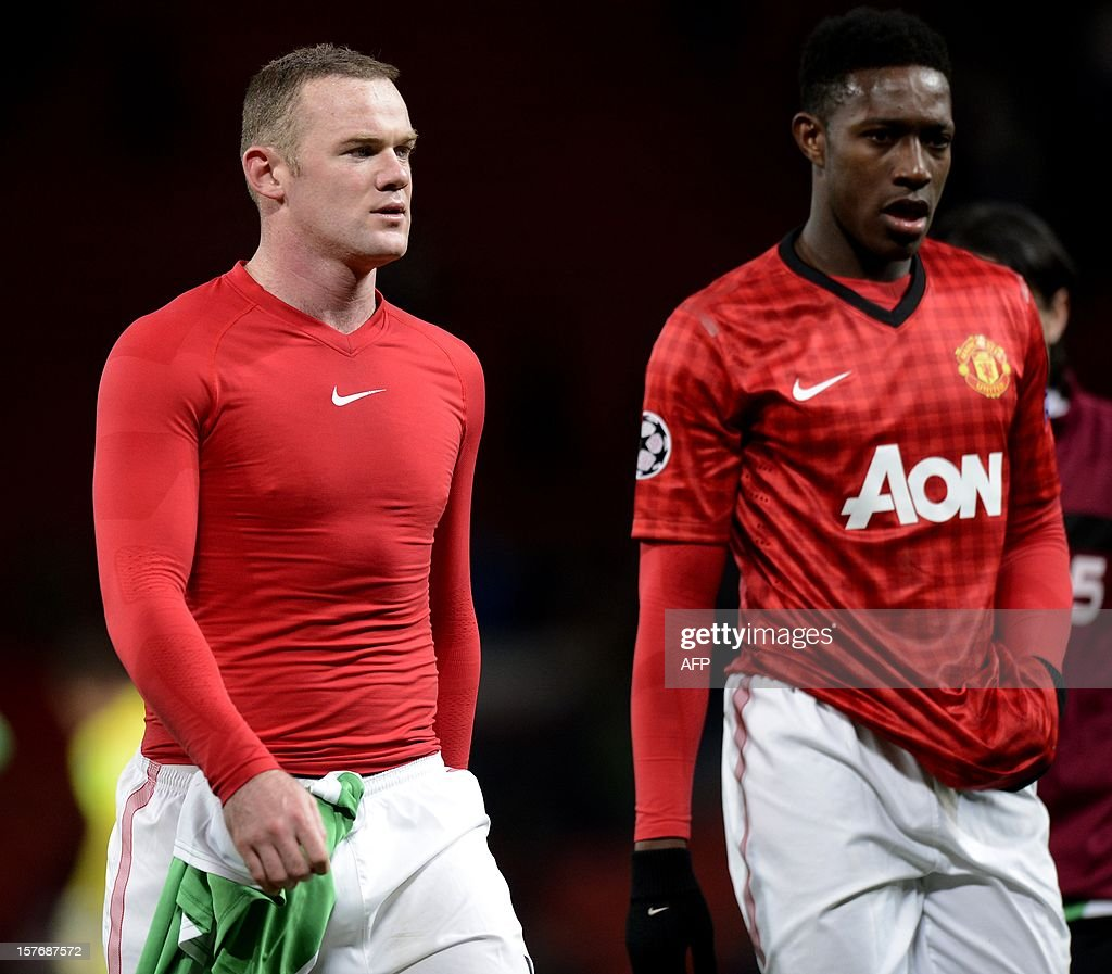 Manchester United's English forward Wayne Rooney (L) and Manchester United's English forward Danny Welbeck leave the pitch after the 1-0 defeat to CFR Cluj-Napoca during the UEFA Champions League group H football match between Manchester United and CFR Cluj-Napoca at Old Trafford in Manchester, north-west England, on December 5, 2012. CFR Cluj-Napoca won 1-0.