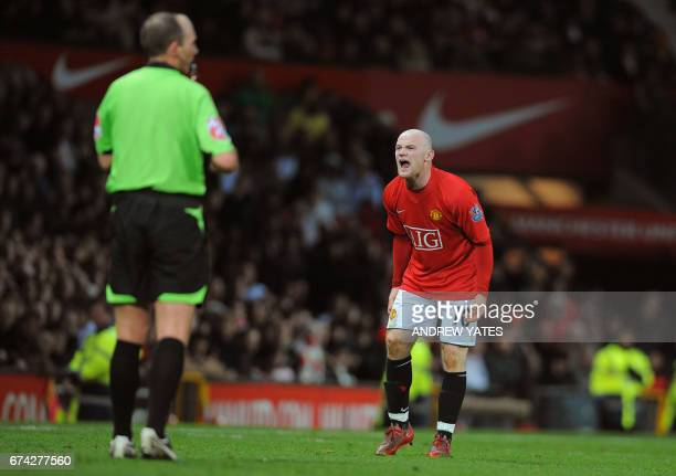 Manchester United's English forward Wayne Rooney reacts to a referee's decision during the English Premier league football match against Hull City at...