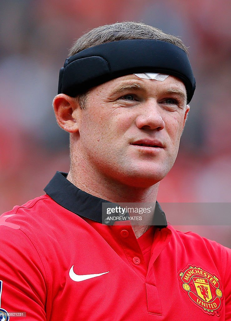 Manchester United's English forward Wayne Rooney wears a headband and bandage to cover a head injury gained in training during the English Premier League football match between Manchester United and Crystal Palace at Old Trafford in Manchester, northwest England, on September 14, 2013. USE. No use with unauthorized audio, video, data, fixture lists, club/league logos or live services. Online in-match use limited to 45 images, no video emulation. No use in betting, games or single club/league/player publications